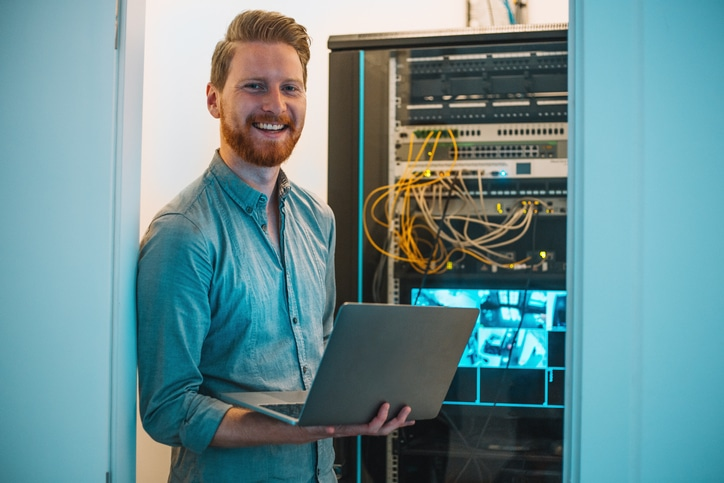 Computer Engineer Helping Small Business Owner